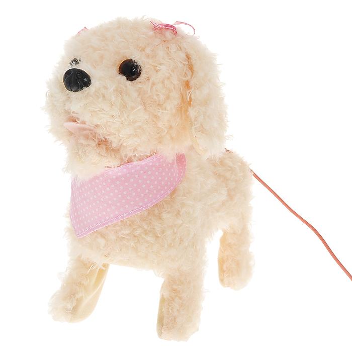 """Интерактивная игрушка """"Умняша"""" развлечет вашего ребенка и станет для него любимой игрушкой. Игрушка выполнена в виде симпатичного бежевого щенка, на грудку которого повязана розовая косынка, а ушки украшают маленькие розовые бантики. В комплект с игрушкой входит пульт дистанционного управления, выполненный в виде поводка. Щенок умеет лаять, вилять хвостом и ходить. Интерактивная игрушка """"Умняша"""" поднимет настроение вашему малышу и подарит массу положительных эмоций."""