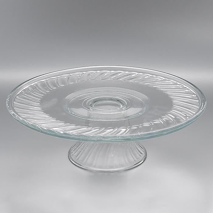 Блюдо для торта Pastelero, диаметр 31 смVT-1520(SR)Блюдо для торта Pastelero, выполненное из высококачественного стекла, оригинально украсит праздничный стол и поможет красиво расположить торт или пирог. Блюдо установлено на изящную ножку. Функциональность и эстетичность блюда Pastelero порадует любую хозяйку. Характеристики:Материал: стекло. Диаметр блюда: 31 см. Высота блюда: 12 см. Размер упаковки: 31 см х 31 см х 11 см. Артикул: Мк 55543 (7696).
