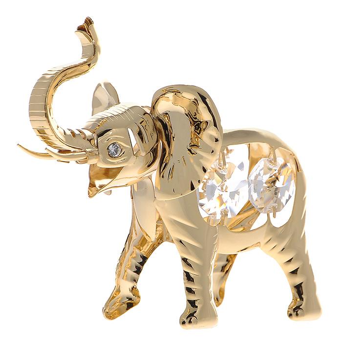 Сувенир Слон, цвет: золотистый. 42492174-0120Сувенир Слон выполнен из позолоченного металла и украшен белыми кристаллами Swarovski. Поставьте фигурку на стол в офисе или дома и наслаждайтесь изящными формами и блеском кристаллов.Изысканный и эффектный, этот сувенир покорит своей красотой и изумительным качеством исполнения, а также станет замечательным и оригинальным подарком. Характеристики:Материал: металл, кристаллы Swarovski. Размер сувенира: 9 см х 3 см х 7 см. Цвет: золотистый. Размер упаковки: 6 см х 6 см х 9 см. Артикул: 424921.