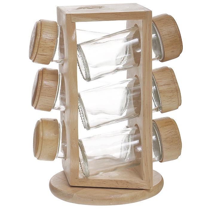 Набор для специй Oriental way, 7 предметов. S4036WVT-1520(SR)Набор для специй Oriental way представляет собой вращающуюся полку с шестью стеклянными емкостями. Подставка изготовлена из дерева гевея. Емкости для специй, выполненные из стекла, имеют перфорированную пластиковую накладку и завинчивающуюся деревянную крышку. Особенности набора Oriental way: высокое качество шлифовки поверхности изделий; двухслойное покрытие пищевым лаком, безопасным для здоровья человека; степень влажности 8-10%, не трескается и не рассыхается; высокая плотность структуры древесины; устойчивость к механическим воздействиям. Характеристики:Материал: дерево (гевея), стекло. Объем емкости для специй: 75 мл. Диаметр емкости для специй: 4 см. Высота емкости для специй: 10 см. Диаметр основания подставки: 12 см. Высота подставки: 20 см. Размеры упаковки: 13,5 см х 12,5 см х 20,5 см. Артикул: S4036W. Торговая марка Oriental way известна на рынке с 1996 года. Эта марка объединяет товары для кухни, изготовленные из дерева и других материалов. Все товары марки Oriental way являются безопасными для здоровья, экологичными, прочными и долговечными в использовании.