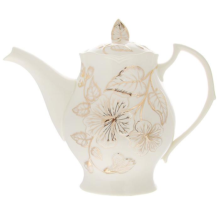 Чайник заварочный Желтый цветок, 1 л54 009312Заварочный чайник Желтый цветок изготовлен из высококачественного фарфора белого цвета. Он имеет изящную форму и декорирован нежным цветочным рисунком. Чайник сочетает в себе стильный дизайн с максимальной функциональностью. Красочность оформления придется по вкусу и ценителям классики, и тем, кто предпочитает утонченность и изысканность. Чайник упакован в подарочную коробку из плотного золотистого картона. Внутренняя часть коробки задрапирована белым атласом, и чайник надежно крепится в определенном положении благодаря особым выемкам в коробке.Размер чайника (без крышки) (Д х Ш х В): 23 х 9 х 16 см.
