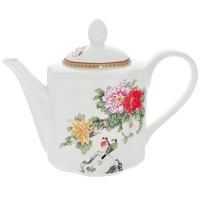 Чайник заварочный Японский сад, 1 л68/5/4Чайник Японский сад, выполненный из высококачественной керамики и оформленный нежным цветочным рисунком, станет незаменимым помощником на кухне. Он сочетает в себе изысканный дизайн с максимальной функциональностью.Такой чайник станет незаменимым атрибутом чаепития и послужит не только приятным подарком, но и практичным сувениром.Размер чайника (без учета крышки) (Д х Ш х В): 24 х 10 х 13 см.