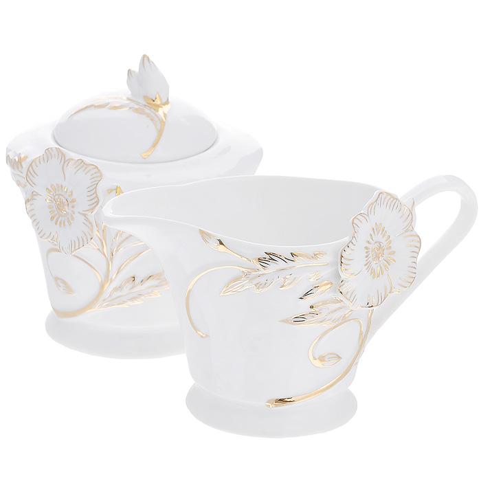 Набор Золотой цветок, 2 предмета115510Набор Золотой цветок состоит из сахарницы и молочника, выполненных из высококачественного фарфора белого цвета. Изделия декорированы рельефным цветком, покрытым золотистой эмалью. Такой набор прекрасно подойдет для сервировки стола и станет незаменимым атрибутом чаепития. Набор упакован в подарочную коробку из плотного золотистого картона. Внутренняя часть коробки задрапирована белой атласной тканью, и каждый предмет надежно крепится в определенном положении благодаря особым выемкам в коробке. Характеристики:Материал: фарфор. Объем молочника: 200 мл. Размер молочника (Д х Ш х В): 14 см х 9 см х 8 см. Объем сахарницы: 250 мл. Диаметр сахарницы: 9,5 см. Высота сахарницы (с учетом крышки): 10,5 см. Размер упаковки: 26 см х 13,5 см х 10,5 см. Артикул: 595-153.
