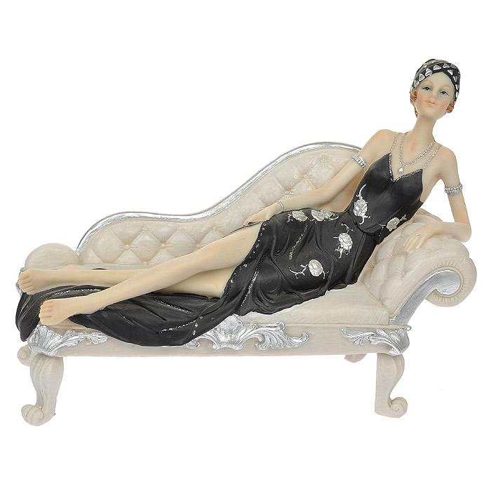 Статуэтка Вечерняя нега, высота 19 см17784Статуэтка Вечерняя нега, выполненная из полистоуна, станет отличным украшением интерьера вашего дома или офиса. Статуэтка выполнена в виде изящной дамы в черном платье, лежащей на тахте.Вы можете поставить статуэтку в любом месте, где она будет удачно смотреться, и радовать глаз. Также она может стать оригинальным подарком для всех любителей стильных вещей. Характеристики:Материал: полистоун. Размер статуэтки (Ш х Д х В): 27 см х 10 см х 19 см. Размер упаковки: 15,5 см х 23,5 см х 31,5 см. Артикул: 512-117.