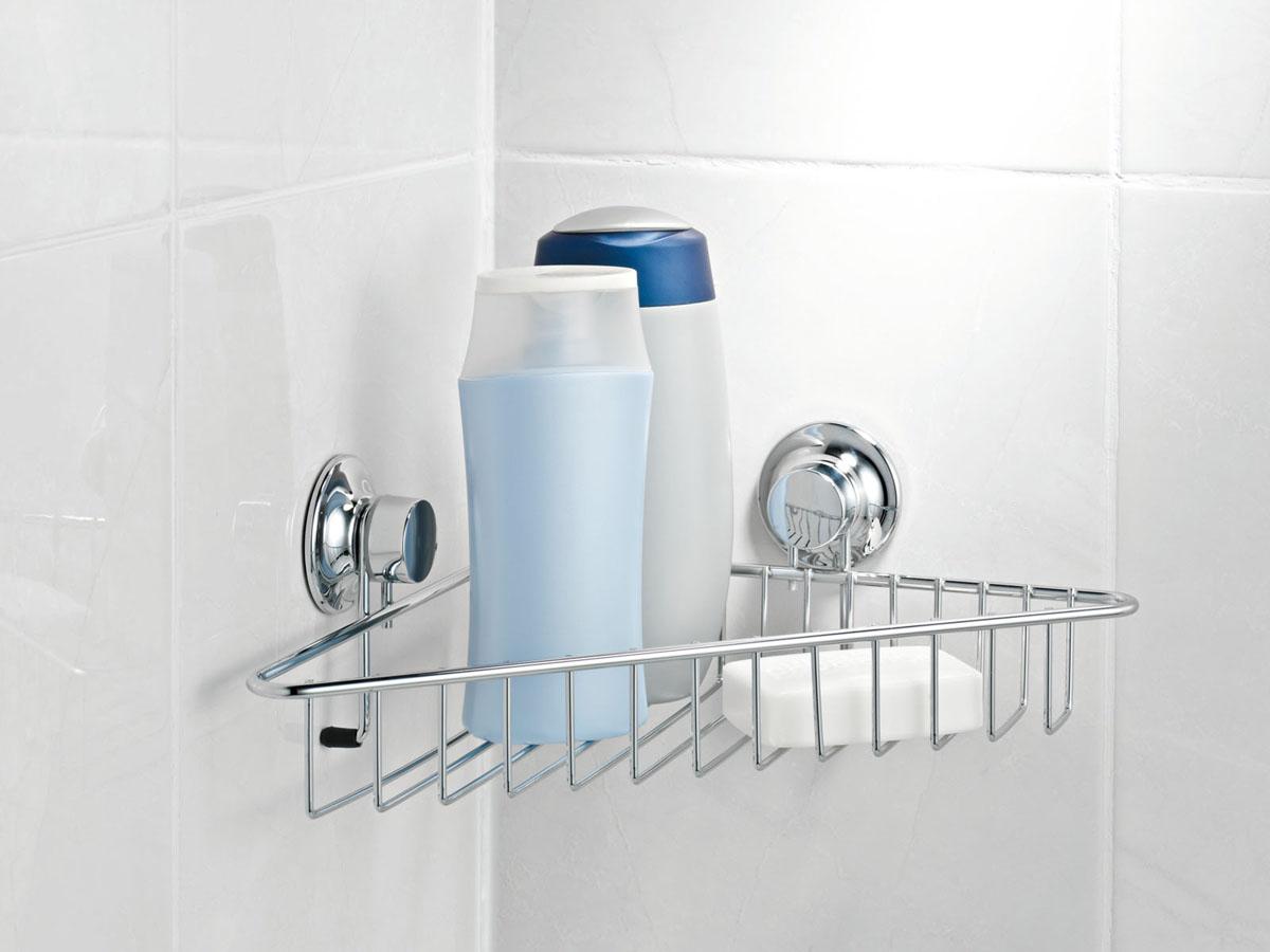 Полка для ванной Tatkraft Swiss Line, одноярусная, угловая, 33,6 см х 23,5 см х 7,5 см391602Полка Tatkraft Swiss Line просто создана для современной ванной комнаты. Стильная, легкая, она позволит вам сэкономить место и уместить гораздо больше вещей, чем вы можете предположить. Полка препится при помощи 2-х присосок. Характеристики:Материал:металл. Размер:33,6 см х 23,5 см х 7,5 см. Размер упаковкти:9 см х 33 см х 18 см.