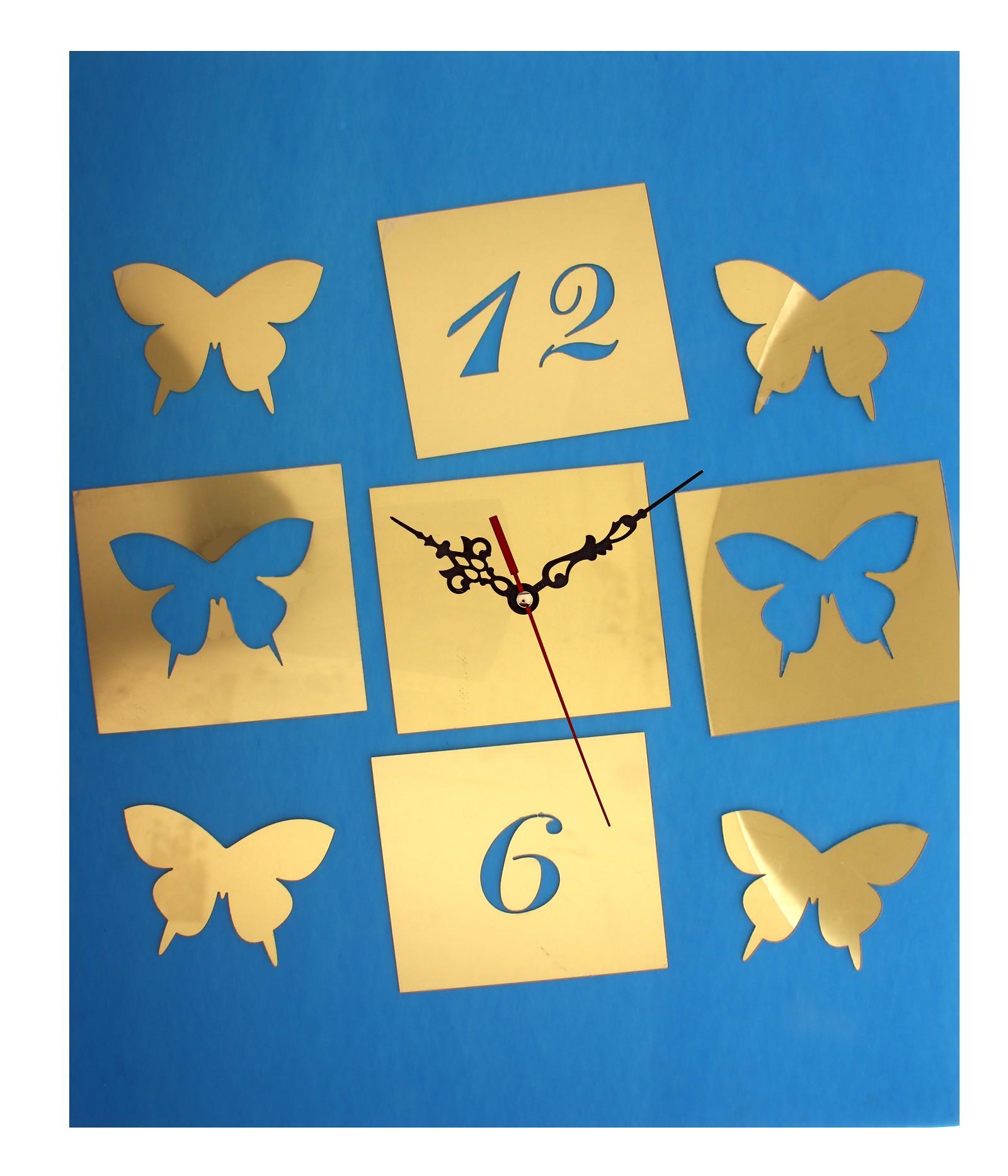 Часы-наклейка Бабочки, 60 х 44 см 729553300074_ежевикаЧасы-наклейка Бабочки изготовлены из пластика золотистого цвета с глянцевой поверхностью. Часы выполнены в виде круглого основания (циферблат), в которое вставляется часовой механизм со стрелками. Для большего декоративного эффекта к основанию прилагаются дополнительные наклейки в виде бабочек.Если Вы – любитель перестановок или вам приходится часто переезжать, то часы-наклейка многоразового использования – это то, что вам нужно: они не требуют гвоздей в стене и фиксации на одном месте.Легкие и компактные они украсят интерьер и никогда не примелькаются. Характеристики:Материал: пластик. Цвет: золотистый. Диаметр основания: 13 см. Размер композиции: 60 см х 44 см. Длина стрелки: 12 см. Изготовитель: Китай. Артикул: 729553.
