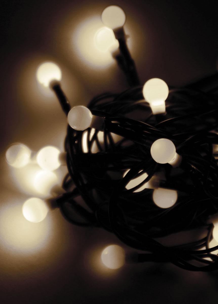 Светодиодная гирлянда Космос Шарики, 30 светодиодов, цвет свечения: белый, 4,4 мKOC_GIR30LEDBALL_RGBСветодиодная гирлянда Космос Шарики с пластиковыми насадками в виде маленьких шариков отлично подойдет для украшения новогодней елки, окна или стены. На гирлянде расположено 30 лампочек. Провод гирлянды темно-зеленого цвета оснащен прямоугольным контролером с кнопкой для переключения восьми режимов. Режимы мигания электрогирлянды: combination (комбинированный); in wales (волна); sequentian (последовательный); slo-glo;chasing/flash (чеканка/вспышка) ; slow fade (медленное затухание);twinkle/flash (мерцание/вспышка); steady on (постоянный). Светодиодная гирлянда Космос Шарики создаст праздничную атмосферу и наполнит ваш дом радостью и позитивной энергией. Характеристики:Материал: пластик. Цвет свечения: белый. Количество светодиодов: 30 шт. Длина гирлянды: 4,4 м. Диаметр шарика: 1 см. Режимы мигания: 8. Электропитание (от сети): 230 В. Артикул: KOC_GIR30LEDBALL_W.