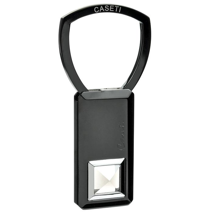 Брелок Caseti. CBG30107 (4)il-32Стильный брелок Caseti выполнен из латунного сплава с черным лаковым покрытием и представляет собой небольшую пластинку, декорированную черным стразом. Брелок Caseti прекрасно подойдет представительному мужчине и подчеркнет изысканный вкус своего владельца. Брелок хранится в фирменном подарочном футляре из плотного картона, задрапированном мягкой тканью.Caseti - это аксессуары для мужчин, созданные подчеркнуть истинный образ джентльмена, разработанные европейскими дизайнерами и отражающие все тенденции современной моды. В ассортименте Caseti отражается классический стиль, где эстетическая привлекательность и качество сочетаются с мастерством изготовления и роскошью. Характеристики: Материал: латунный сплав. Отделка: лак, стекло. Общая высота брелока: 6,7 см. Размер пластинки: 2 см x 4 см x 0,35 см. Размер упаковки: 10 см x 10 см x 4 см. Артикул: CBG30107 (4).