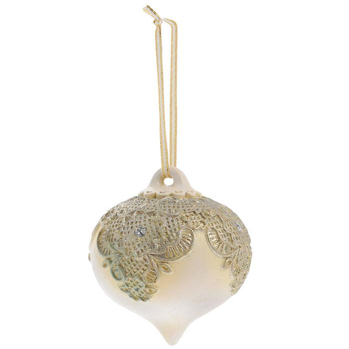 Новогоднее подвесное украшение Юла, цвет: бежевый. 2596525365Изящное новогоднее украшение выполнено из полирезины в виде юлы, декорированной блестками и стразами. С помощью специальной петельки украшение можно повесить в любом понравившемся вам месте. Но, конечно, удачнее всего такая игрушка будет смотреться на праздничной елке.Новогодние украшения приносят в дом волшебство и ощущение праздника. Создайте в своем доме атмосферу веселья и радости, украшая всей семьей новогоднюю елку нарядными игрушками, которые будут из года в год накапливать теплоту воспоминаний. Коллекция декоративных украшений из серии Magic Time принесет в ваш дом ни с чем несравнимое ощущение волшебства! Характеристики:Материал: полирезина, текстиль, блестки, стразы. Цвет: бежевый. Размер украшения: 7,5 см х 7,5 см х 8,5 см. Артикул: 25965.