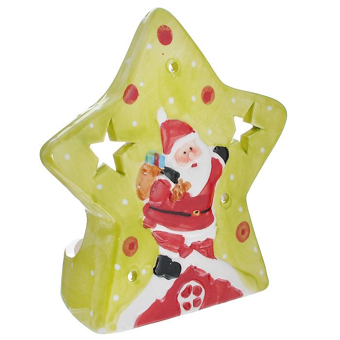 Подсвечник Дед Мороз, цвет: красный, салатовый175490Подсвечник Дед Мороз выполнен из керамики. Подсвечник украшен изображением Деда Мороза. По всей поверхности имеются отверстия круглой формы, а также отверстия в виде звезд, благодаря которым при горении свечи в комнате будет создаваться притягательное и завораживающее мерцание.Новогодние украшения приносят в дом волшебство и ощущение праздника. Создайте в своем доме атмосферу веселья и радости. Характеристики:Материал: керамика. Цвет: красный, салатовый. Размер подсвечника: 11,5 см х 11,5 см х 6 см. Артикул: 119707.