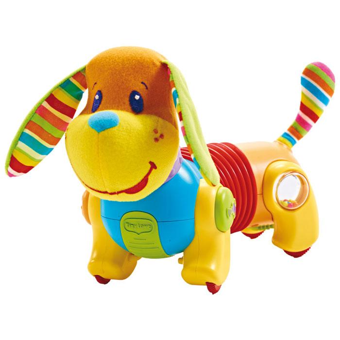 """Развивающая игрушка Tiny Love """"Догони меня: Собачка Фрэд"""" не оставит равнодушным вашего малыша. Игрушка представляет собой собачку, голова и хвост которой выполнены из приятного на ощупь текстильного материала, туловище - из пластика. Ушки собачки шуршат. На задних лапках располагаются встроенные прозрачные вставки-погремушки, задняя стенка которых представляет собой зеркало. На передних лапках собачки находятся кнопки, при нажатии на которые зазвучит веселая музыка. Игрушка снабжена четырьмя колесиками с ограничителем скорости на одном из них, благодаря которым малыш может катать игрушку, наблюдая, как крутятся шарики внутри погремушек. Часть туловища собачки представляет собой вставку-""""гармошку"""", которая позволяет осуществлять движение по прямой или по кругу. Развивающая игрушка Tiny Love """"Догони меня: Собачка Фрэд"""" волшебным образом поднимет настроение вашего малыша, побуждая ползать за ней, а также поможет ему в развитии цветового и звукового восприятия, мелкой..."""