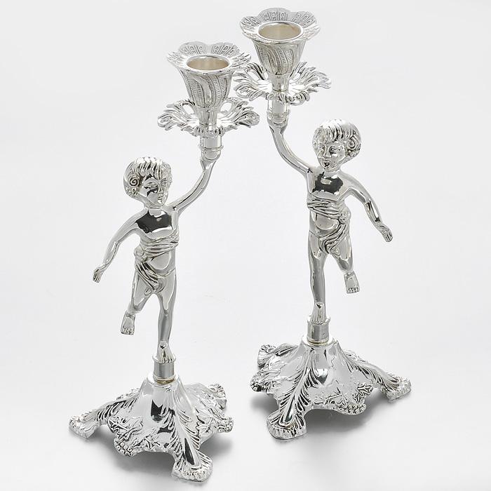 Набор декоративных подсвечников Marquis Ангелы, 2 шт. 1051-MRRH5610Набор Marquis Ангелы состоит их двух декоративных подсвечников, выполненных из стали с серебряно-никелевым покрытием. Подсвечники стилизованы под старину и предназначены для тонких классических свечей. Ножки подсвечников оформлены фигурками ангелов. Такие подсвечники позволят вам украсить интерьер дома или рабочего кабинета оригинальным образом. С таким набором вы сможете не просто внести в интерьер своего дома элемент необычности, но и создать атмосферу загадочности и изысканности. Характеристики:Материал: сталь с серебряно-никелевым покрытием. Комплектация: 2 шт. Цвет: серебристый. Высота подсвечника: 24 см. Размер основания: 9,5 см х 9,5 см. Диаметр углубления для свечи: 2,2 см. Размер упаковки: 14 см х 10 см х 26 см. Артикул: 1051-MR.