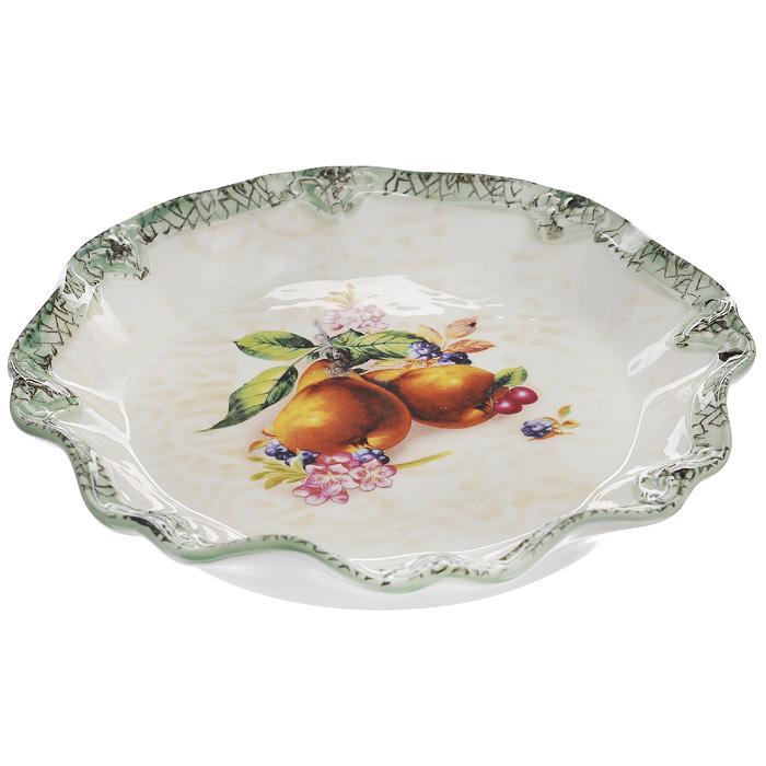 Блюдо Lillo, диаметр 20,5 см. 213469VT-1520(SR)Блюдо Lillo выполнено из высококачественой керамики. Блюдо кремового цвета оформлено зеленой каймой и украшено рисунком в виде фруктов и ягод. Данное блюдо сочетает в себе изысканный дизайн с максимальной функциональностью. Красочность оформления придется по вкусу и ценителям классики, и тем, кто предпочитает утонченность и изысканность. Характеристики: Материал:керамика. Цвет: кремовый, зеленый. Диаметр блюда: 20,5 см. Высота блюда: 3 см. Размеры упаковки: 4 см х 20 см х 20,5 см. Артикул: 213469.