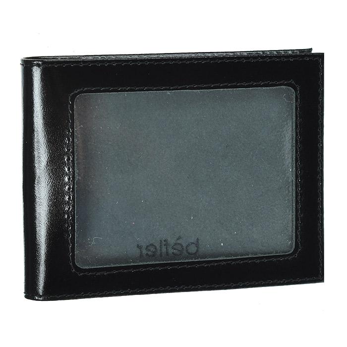 Обложка для удостоверения Befler, цвет: черный. F.13.-1INT-06501Стильная обложка для удостоверения Befler не только поможет сохранить внешний вид ваших документов и защитит их от повреждений, но и станет стильным аксессуаром, идеально подходящим вашему образу. Обложка выполнена из натуральной кожи светло-коричневого цвета с окошком из прозрачного пластика. Внутри - два кармана из прозрачного пластика. Характеристики:Материал: натуральная кожа. Цвет: черный. Размер обложки: 10,5 см х 8 см х 1 см. Артикул:F.13.-1.