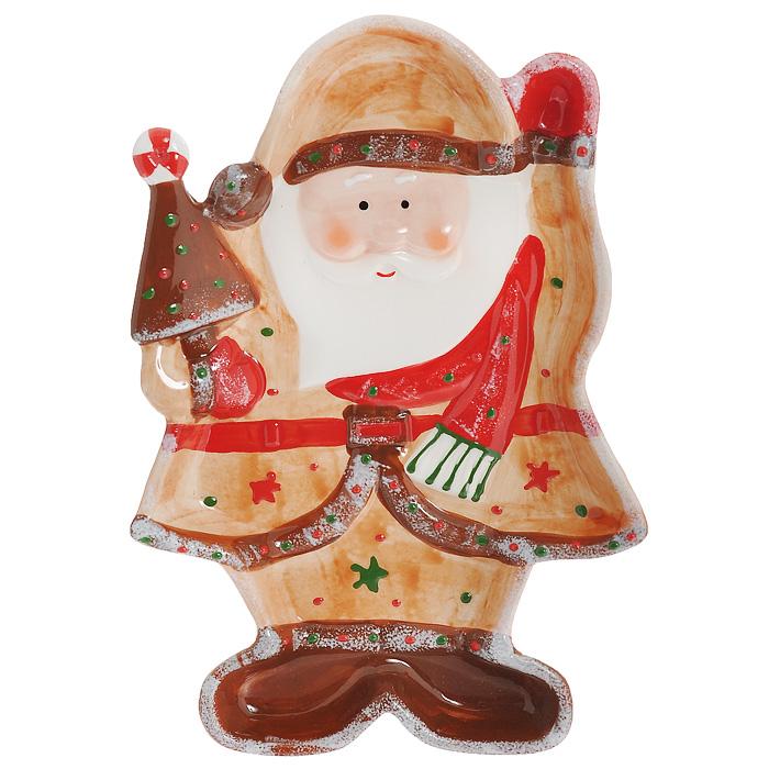 Блюдо Дед Мороз, 25,5 х 17,5 х 3 см115010Блюдо Дед Мороз выполнено из высококачественного фаянса. Блюдо изготовлено в виде Деда Мороза с елочкой в руке. Данное блюдо сочетает в себе оригинальный дизайн с максимальной функциональностью. Красочность оформления особенно подойдет для новогоднего торжества. Характеристики: Материал:фаянс. Размер блюда (Д х Ш х В): 25,5 см х 17,5 см х 3 см. Размеры упаковки: 26 см х 18 см х 4 см. Артикул: YM121171-2C.