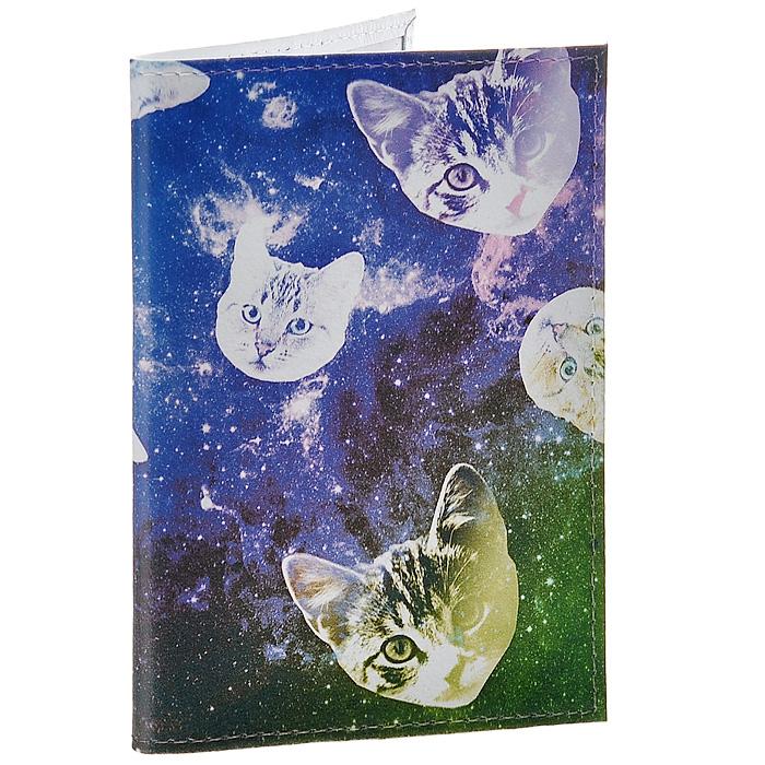 Обложка для паспорта Сны о кошках . OK195INT-06501Обложка для паспорта Mitya Veselkov, выполненная из натуральной кожи, оформлена изображением кошачьих мордочек на фоне звездного неба. Такая обложка не только поможет сохранить внешний вид ваших документов и защитит их от повреждений, но и станет стильным аксессуаром, идеально подходящим вашему образу. Яркая и оригинальная обложка подчеркнет вашу индивидуальность и изысканный вкус. Обложка для паспорта стильного дизайна может быть достойным и оригинальным подарком.Характеристики:Материал: натуральная кожа, пластик. Размер (в сложенном виде): 9,5 см х 13,5 см. Артикул: OK195.