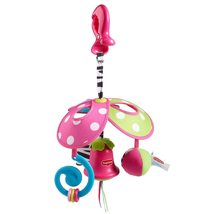 """Игрушка-подвеска Tiny Love """"Веселая карусель: Моя Принцесса"""" предназначена для детей с самого рождения. Благодаря своей яркой расцветке и приятному на ощупь материалу игрушка привлечет внимание малыша и в игровой форме позволит ему развиваться. Игрушка выполнена из безопасных материалов и представляет собой карусель, состоящую из трех лепестков. К лепесткам подвешены мягкий мячик-погремушка, анатомический прорезыватель с тремя колечками, которые малыш сможет передвигать, и шуршащая звездочка с небольшим безопасным зеркальцем круглой формы и тремя короткими шнурочками. В нижней части игрушки к центру подвешен китайский колокольчик с тремя короткими атласными ленточками разных цветов. Колокольчик мелодично звенит каждый раз, когда до него дотрагиваются. Благодаря пластиковой клипсе, прикрепленной к карусели с помощью текстильного шнурка, игрушку можно подвесить к кроватке, коляске, автокреслу или игровой дуге малыша. Яркая игрушка-подвеска Tiny Love """"Веселая карусель""""..."""
