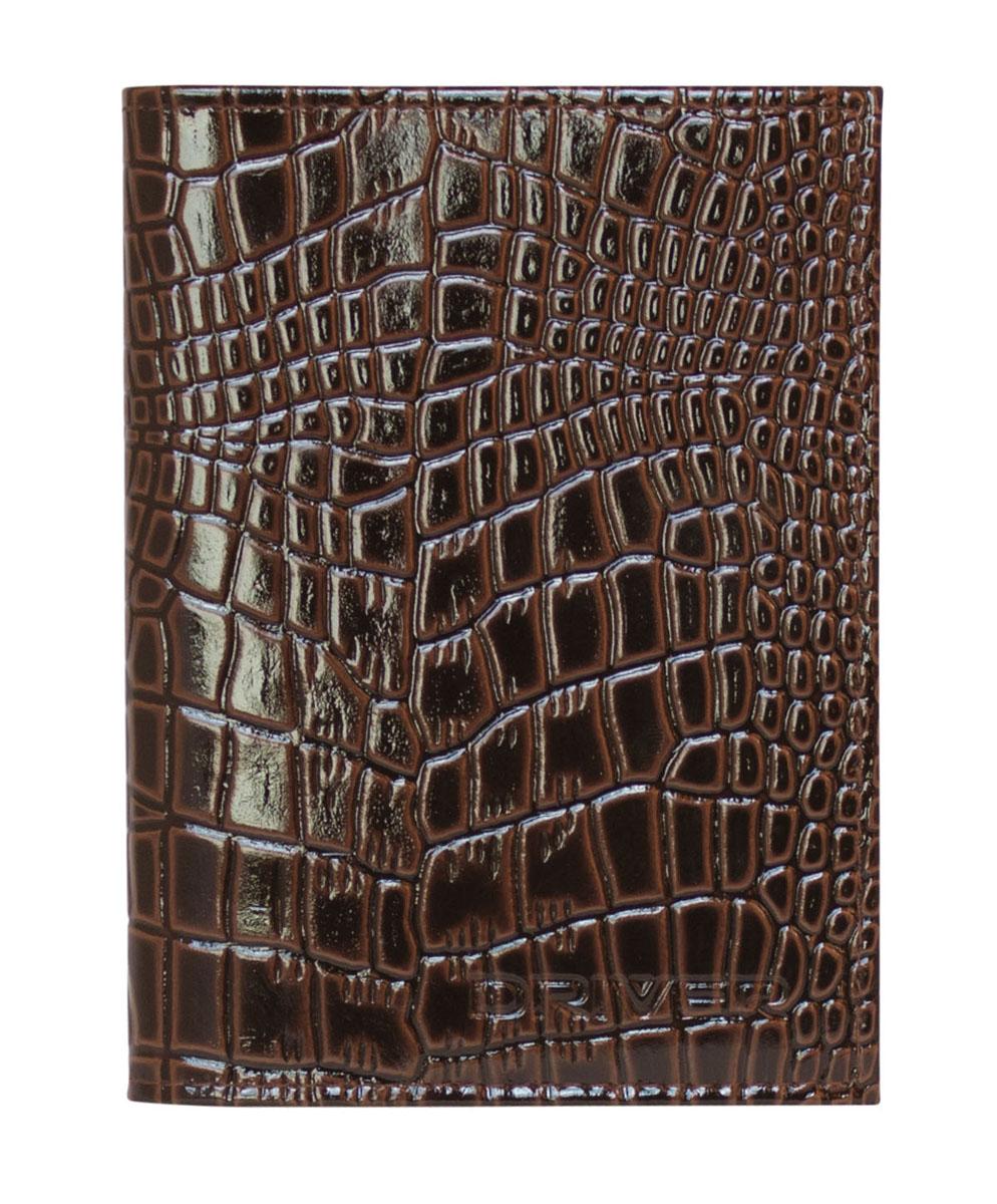 Обложка для автодокументов Driver, цвет: коричневый. АО4СР961Обложка для автодокументов Driver выполнена из высококачественной натуральной глянцевой кожи коричневого цвета и оформлена декоративным теснением под крокодила. На внутреннем развороте - съемный блок из шести прозрачных файлов из мягкого пластика, один из которых формата А5. Также обложка имеет два маленьких отделения для хранения sim-карт.Обложка не только поможет сохранить внешний вид ваших документов и защитит их от повреждений, но и станет стильным аксессуаром, который подчеркнет ваш неповторимый стиль. Кожгалантерея Driver изготовлена из высококачественной натуральной кожи. Специальное защитное покрытие способствует долгой службе изделий. Вся продукция гипоаллергенна. Прозрачные растительные краски подчеркивают натуральную фактуру. Множество отделений позволит сохранить документы в порядке. Характеристики: Материал: натуральная кожа, ПВХ. Размер обложки: 9,5 см х 12,5 см. Размер упаковки: 9,5 см х 1,5 см х 17,5 см. Цвет: коричневый. Производитель: Россия. Артикул: АО4СР.