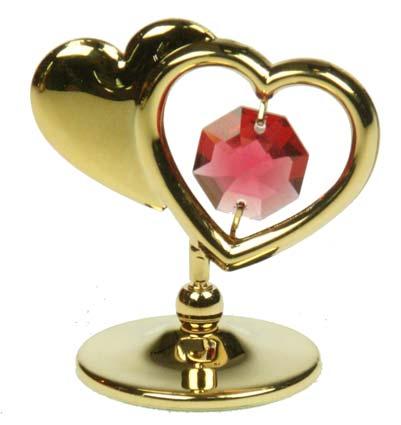 Фигурка декоративная Сердца, цвет: золотистый. 6736741619Декоративная фигурка Сердца, золотистого цвета, станет необычным аксессуаром для вашего интерьера и создаст незабываемую атмосферу. Фигурка выполнена в виде двух сердечек на подставке. Одно сердечко инкрустировано розовым кристаллом, а второе оформлено надписью Love. Кристаллы, украшающие фигурку, носят громкое имяSwarovski. Ограненные, как бриллианты, кристаллы блистают сотнями тысяч различных оттенков.Эта очаровательная вещь послужит отличным подарком близкому человеку, родственнику или другу, а также подарит приятные мгновения и окунет вас в лучшие воспоминания.Фигурка упакована в подарочную коробку. Характеристики:Материал: металл (углеродистая сталь, покрытие золотом 0,05 микрон), австрийские кристаллы. Размер фигурки (с подставкой): 4,5 см х 4,5 см х 3 см. Цвет: золотистый. Размер упаковки: 5 см х 3,5 см х 7,5 см. Артикул: 67367. Более чем 30 лет назад компанияCrystocraftвыросла из ведущего производителя в перспективную торговую марку, которая задает тенденцию благодаря безупречному чувству красоты и стиля. Компания создает изящные, качественные, яркие сувениры, декорированные кристалламиSwarovskiразличных размеров и оттенков, сочетающие в себе превосходное мастерство обработки металлов и самое высокое качество кристаллов. Каждое изделие оформлено в индивидуальной подарочной упаковке, что придает ему завершенный и презентабельный вид.
