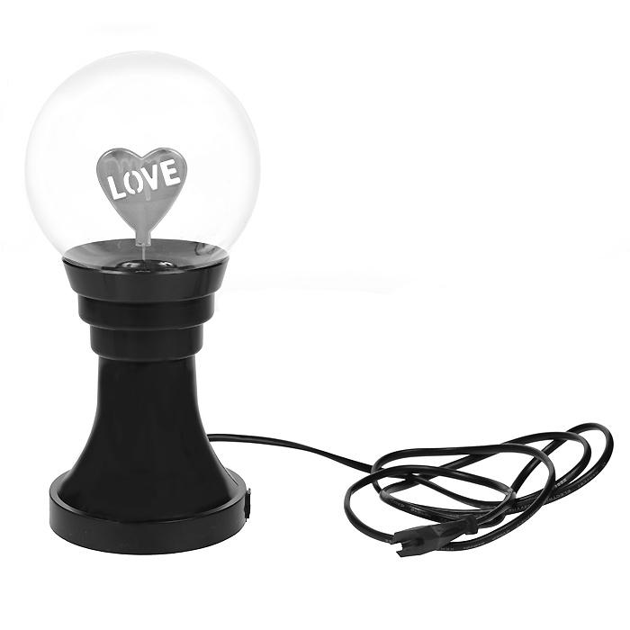 Светильник-плазма Любовь. 40640SZ-14Светильник-плазма Любовь представляет собой стеклянный шар на подставке. Внутри шара расположена фигурка в виде сердечка с надписью Love. При включении внутри стеклянной сферы создается множество цветных молний. Молнии разбегаются во все стороны из центра, а если прикоснуться к поверхности шара пальцем, они сольются в один мощный поток. Светильник работает от электросети. На подставке имеется выключатель, благодаря чему вам не придется постоянно выдергивать шнур из розетки. Светильник-плазма Любовь будет прекрасным дополнением к вашему интерьеру, а так же может послужить замечательным подарком. Характеристики:Материал: пластик, стекло. Общая высота: 26 см. Диаметр шара: 13 см. Диаметр основания:11 см. Цвет подставки: черный. Размер упаковки: 13,5 см х 28 см х 13,5 см. Производитель: Китай. Артикул: 40640.