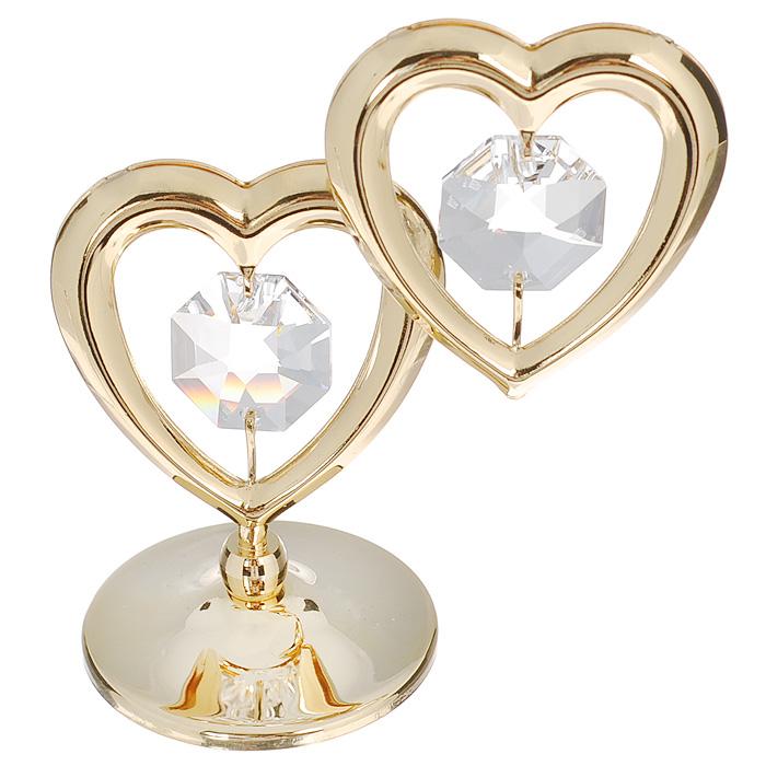 Фигурка декоративная Два сердца, цвет: серебристый, золотистый. 67082OT004Притягательный блеск и невероятная утонченность декоративной фигурки Два сердца великолепно дополнят интерьер и, несомненно, не останутся без внимания. Фигурка выполнена из металла с блестящим золотистым покрытием в виде двух сердечек на шаровидной подставке и украшена двумя крупными кристаллами Swarovski. Декоративная фигурка Два сердца послужит прекрасным подарком ценителю изысканных и элегантных вещиц. Характеристики:Материал: металл, кристаллы Swarovski. Размер фигурки: 6 см х 0,5 см х 7 см. Цвет: серебристый, золотистый. Артикул: 67082.