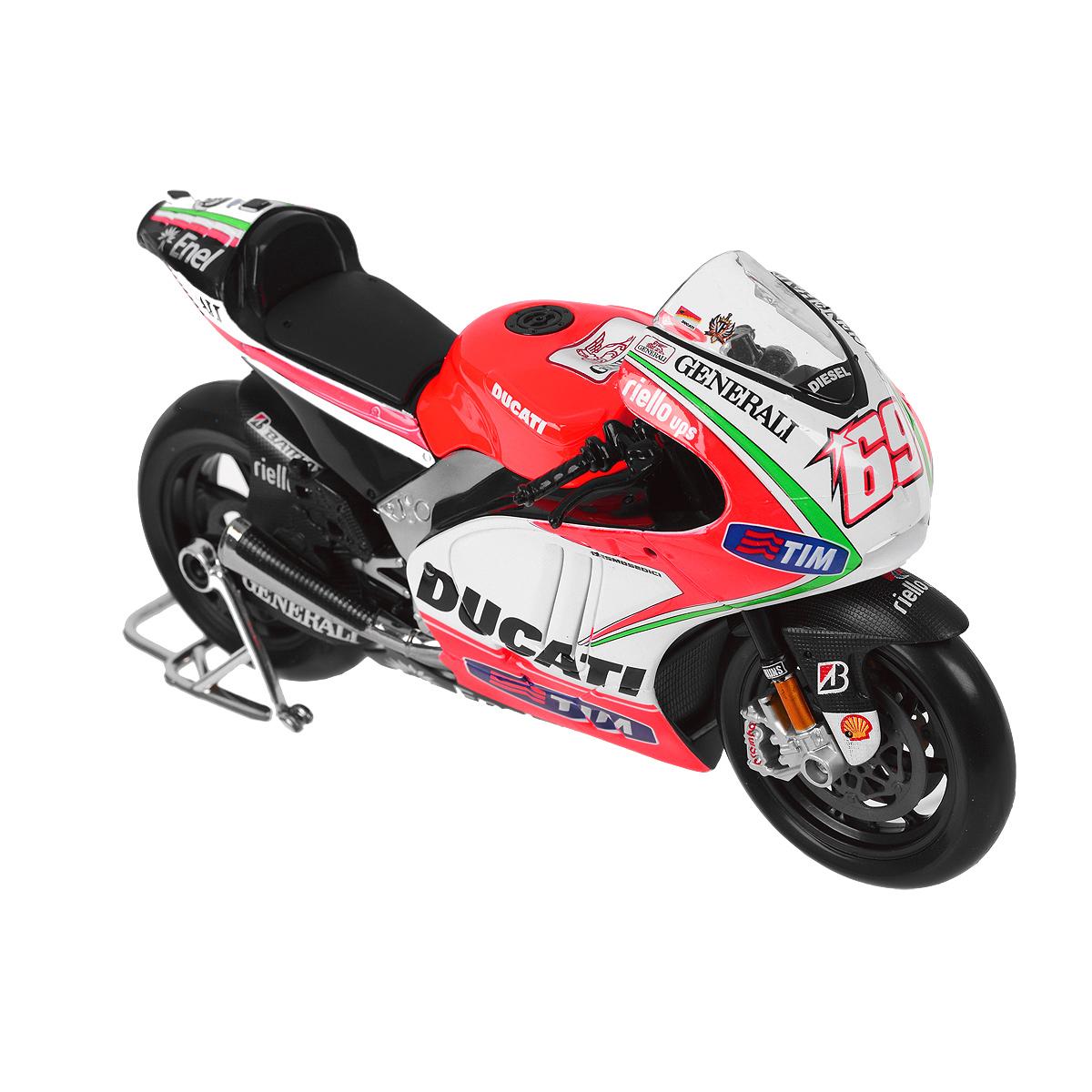 """Коллекционная модель """"Ducati Demosedici 2012"""" - миниатюрная копия настоящего мотоцикла. Стильная модель мотоцикла привлечет к себе внимание не только детей, но и взрослых. Модель имеет литой металлический корпус с высокой детализацией, оснащена колесами из мягкой резины. Игрушка в точности повторяет модель оригинальной техники, подробная детализация в полной мере позволит вам оценить высокую точность копии этого мотоцикла! Такая модель станет отличным подарком не только любителю мототехники, но и человеку, ценящему оригинальность и изысканность, а качество исполнения представит такой подарок в самом лучшем свете."""