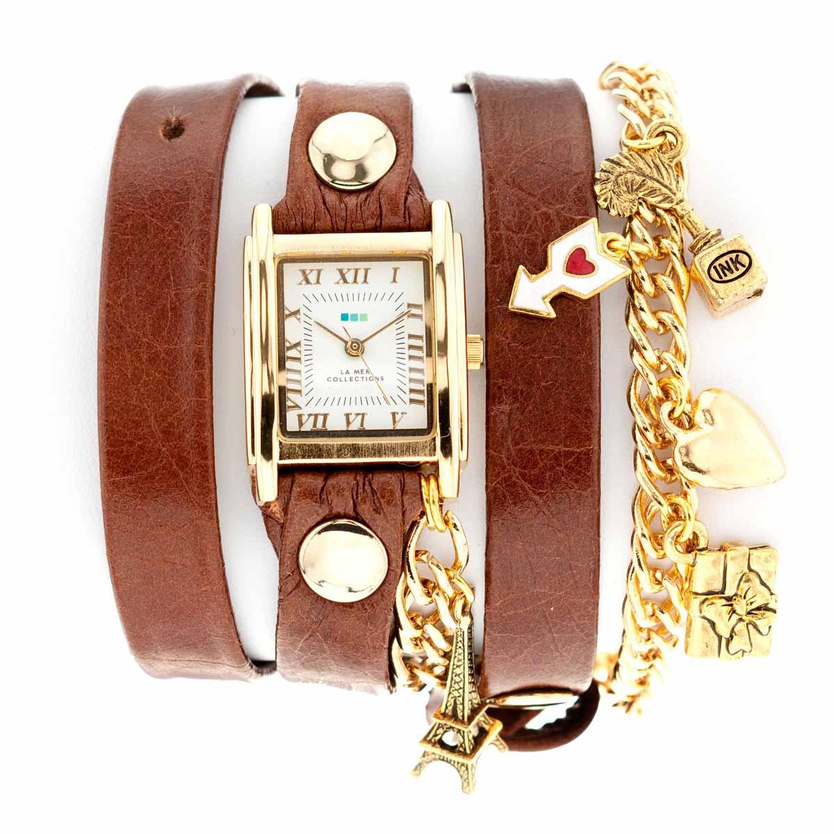 Часы наручные женские La Mer Collections Charm Paris Brown Gold. LMCW3002ABM8434-58AEЧасы оснащены японским кварцевым механизмом. Корпус прямоугольной формы выполнен из нержавеющей стали золотистого цвета. Оригинальный кожаный ремешок коричневого цвета отделан металлическими клепками и дополнен цепочкой.Каждая модель женских наручных часов La Mer Collections имеет эксклюзивный дизайн, в основу которого положено необычное сочетание классических циферблатов с удлиненными кожаными ремешками. Оборачиваясь вокруг запястья несколько раз, они образуют эффект кожаного браслета, превращая часы в женственный аксессуар, который великолепно дополнит другие аксессуары и весь образ в целом.Дизайн La Mer Collections отвечает всем последним тенденциям моды и превосходно сочетается с модными сумками, ремнями, обувью и другими элементами гардероба современных девушек. Часы La Mer - это еще и отличный подарок любимой девушке, сестре или подруге на день рождения, восьмое марта или новый год! Характеристики:Механизм: кварцевый SEIKO (Япония).Размер корпуса: 25 х 22 х 8 мм. Материал корпуса: сплав металлов. Стекло: минеральное. Ремешок: Итальянская натуральная кожа.Размер ремешка: 55 х 1,3 см.Цепочки и украшения: позолота, серебро, олово, медь (не содержат никель).Гарантия: 1 год. Размер упаковки: 10 см x 10 см x 6,5 см.