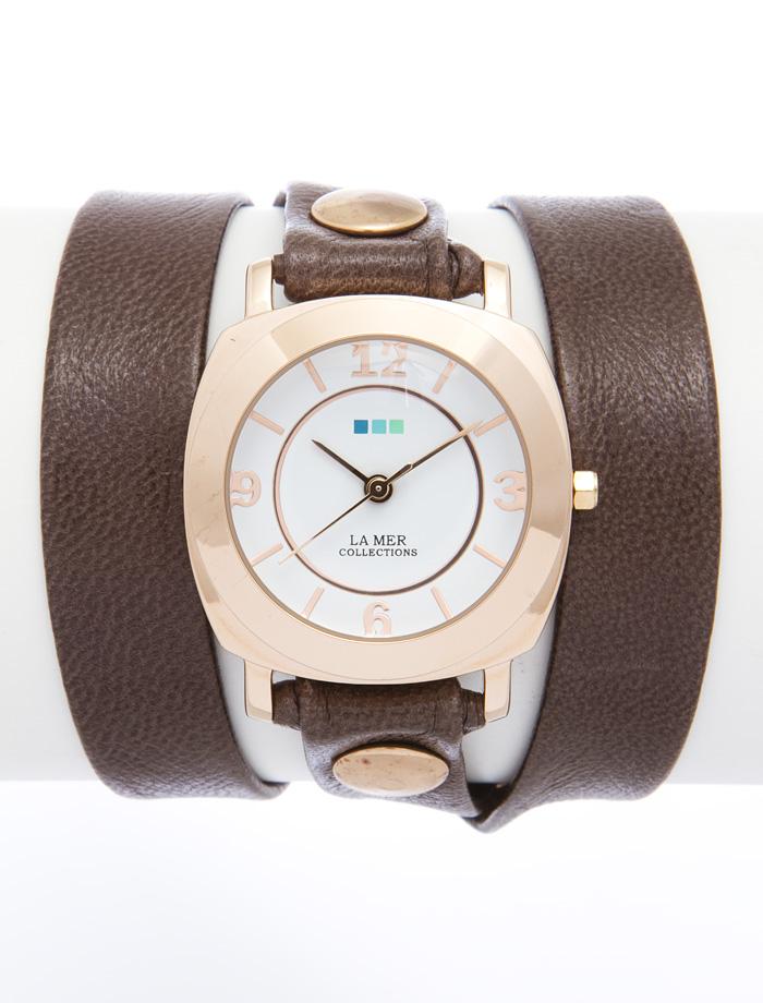 Часы наручные женские La Mer Collections Odyssey Mushroom. LMODY3004BM8434-58AEЧасы оснащены японским кварцевым механизмом. Корпус круглой формы выполнен из нержавеющей стали золотистого цвета. Оригинальный кожаный ремешок коричневого цвета отделан металлическими клепками.Каждая модель женских наручных часов La Mer Collections имеет эксклюзивный дизайн, в основу которого положено необычное сочетание классических циферблатов с удлиненными кожаными ремешками. Оборачиваясь вокруг запястья несколько раз, они образуют эффект кожаного браслета, превращая часы в женственный аксессуар, который великолепно дополнит другие аксессуары и весь образ в целом.Дизайн La Mer Collections отвечает всем последним тенденциям моды и превосходно сочетается с модными сумками, ремнями, обувью и другими элементами гардероба современных девушек. Часы La Mer - это еще и отличный подарок любимой девушке, сестре или подруге на день рождения, восьмое марта или новый год! Характеристики:Механизм: кварцевый SEIKO (Япония).Размер корпуса: 29 х 29 х 8 мм. Материал корпуса: сплав металлов. Стекло: минеральное. Ремешок: Итальянская натуральная кожа. Размер ремешка: 55 х 1,3 см.Гарантия: 1 год. Размер упаковки: 10 см x 10 см x 6,5 см.