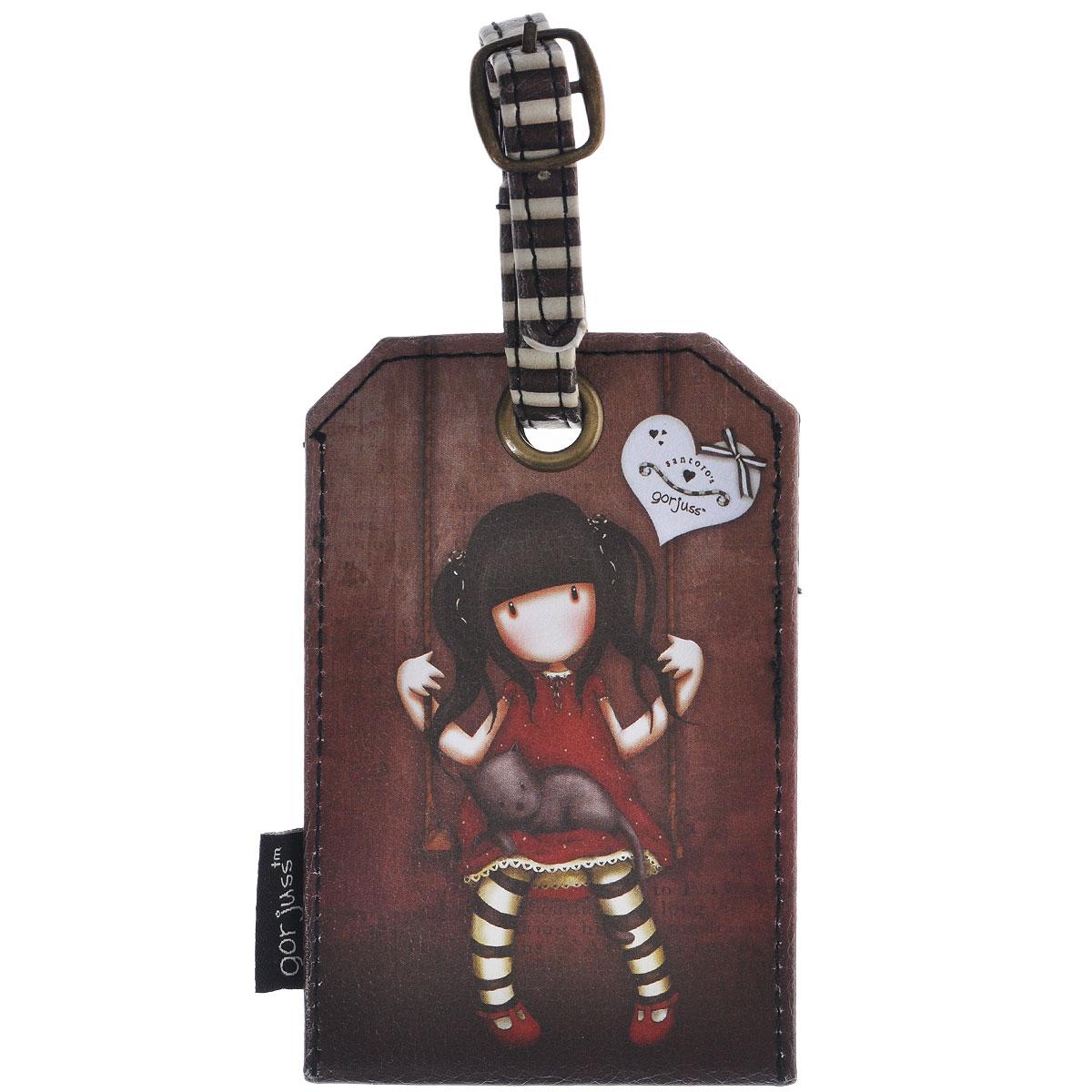 Бирка на багаж Ruby, цвет: коричневый. 0090702Z90 blackОригинальная бирка на багаж Ruby, выполненная из искусственной кожи, декорирована оформлен стилизованным рисунком шотландской художницы Сюзан Вулкотт (Suzanne Woolcott) с изображением основного персонажа своих произведений - девочки Горджус (Gorjuss). Бирка крепится на ремешок.Бирка позволит вам быстро отыскать свой багаж на транспортерной ленте. Аесли ваш багаж отправится в другом направлении, яркая бирка поможетработникам аэропорта скорее найти владельца и доставить багаж. Характеристики:Материал: искусственная кожа, металл. Размер бирки: 11,5 см х 7,5 см х 0,5 см. Производитель: Китай.