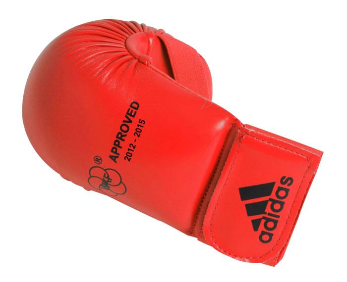 Накладки для карате Adidas WKF Bigger, цвет: красный. 661.22. Размер MУТ-00010471Изогнутые накладки Adidas WKF Bigger с объемным наполнителем необходимы при занятиях спортом для защиты пальцев, суставов и кисти руки в целом от вывихов, ушибов и прочих повреждений. Накладки выполнены из высококачественного полиуретан PU3G. Накладки прочно фиксируются на запястье за счет широкой эластичной ленты на липучке. Удобные и эргономичные накладки Adidas идеально подойдут для занятий карате и другими видами единоборств.Одобрены WKF. Рассчитаны на рост 160-170 см.