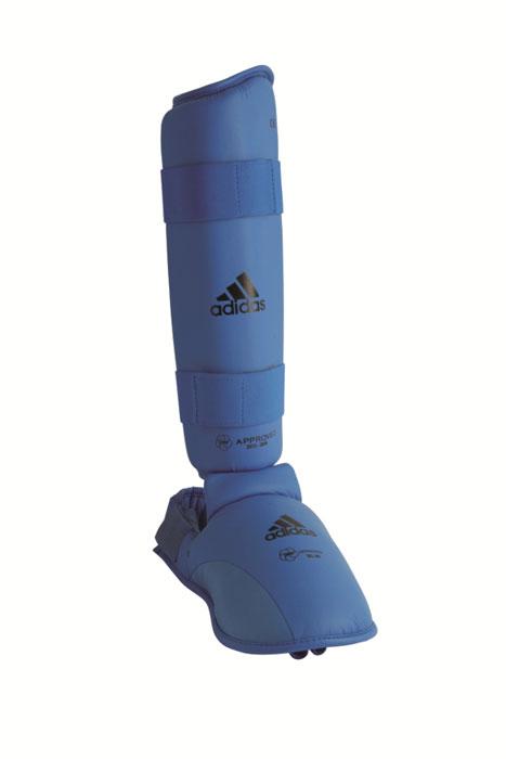 Защита голени и стопы Adidas WKF Shin & Removable Foot, цвет: синий. 661.35. Размер S5131NS р-р XLЗащита голени и стопы Adidas WKF Shin & Removable Foot с объемным наполнителем необходима при занятиях спортом для защиты пальцев, суставов вывихов, ушибов и прочих повреждений. Накладки выполнены из высококачественного полиуретана PU3G. Накладки прочно фиксируются за счет эластичной ленты и липучки. Между собой защита голени и защита стопытакже скрепляются липучкой. Удобные и эргономичные накладки Adidas идеально подойдут для занятий карате и другими видами единоборств.Одобрены WKF.Размер ноги 36-38. Длина защиты голени 34 см.