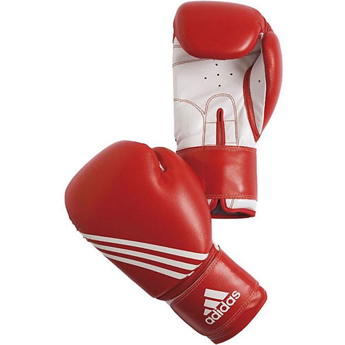 Перчатки боксерские Adidas Training, цвет: красно-белый. adiBT02. Вес 8 унцийBB1637Боксерские перчатки Adidas Training изготовлены из мягкого полиуретана PU3G, который по своим качествам не уступает натуральной коже. Внутренний наполнитель из многослойной пены закрывает тыльную сторону и боковую часть ладони, обеспечивая надежную защиту рук боксера и позволяя безопасно тренироваться в полную силу. Предварительно изогнутый по технологии Intelligent Mould Technology крой перчатки позволяет боксеру держать кулак в правильном положении. Загнутый параллельно кулаку большой палец обеспечивает безопасность при нанесении ударов и защищает большой палец от вывихов и травм. Внутренняя подкладка и вентиляционные отверстия на ладони создают максимальный уровень комфорта для рук, поддерживая оптимальный микроклимат внутри перчаток. Широкий ремень, охватывая запястье, полностью оборачивается вокруг манжеты, благодаря чему создается дополнительная защита лучезапястного сустава от травмирования. Застежка на липучке способствует быстрому и удобному одеванию перчаток, плотно фиксирует перчатки на руке.