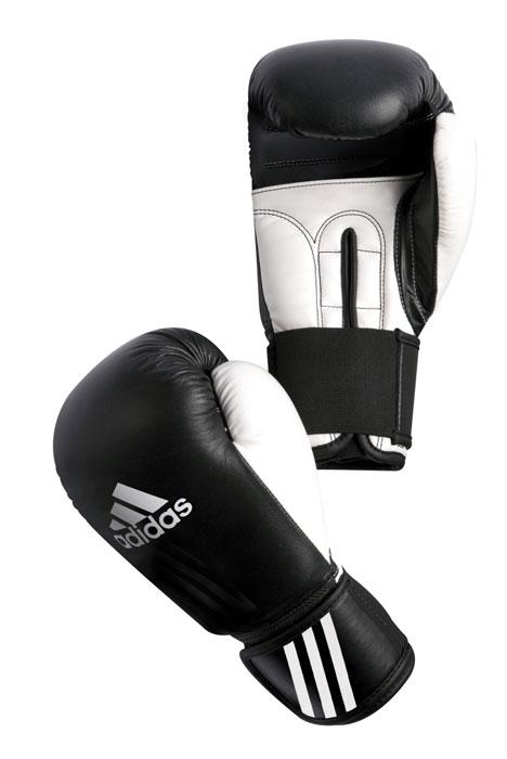 Перчатки боксерские Adidas Performer, цвет: черно-белый. adiBCO1. Вес 10 унцийSF 0085Боксерские перчатки Adidas Performer для отработок ударов и комбинаций. Тыльная сторона в перчатках выполнена из прочной, износостойкой, натуральной кожи. Большой палец и ладонь изготовлены из износостойкого полиуретана. Внутренний наполнитель из формованной под давлением пены с интегрированной внутренней вставкой из геля, выполненной по технологии I-Protech. Внутренний наполнитель покрывает тыльную сторону, создавая надежную защиту рук и давая боксеру возможность безопасно тренироваться в полную силу. Внутренняя подкладка, выполненная из дышащего материала, и вентиляционное отверстие на ладони создают комфортный микроклимат внутри перчаток. Эластичный ремешок с фиксацией на липучке позволяет быстро одеть и снять перчатки.
