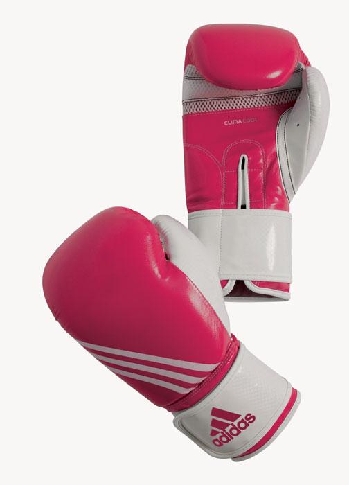 Перчатки боксерские Adidas Fitness, цвет: розово-белый. adiBL05. Вес 12 унцийAIRWHEEL M3-162.8Боксерские перчатки Adidas Fitness изготовлены из искусственной кожи с отделкой внутренней области пальцев. Тренировочная модель. Гелиевая набивка. Фиксация манжеты с помощью эластичной застежки велкро. Система ClimaCool - микровентиляция, способствует полному удалению внутренней влаги.