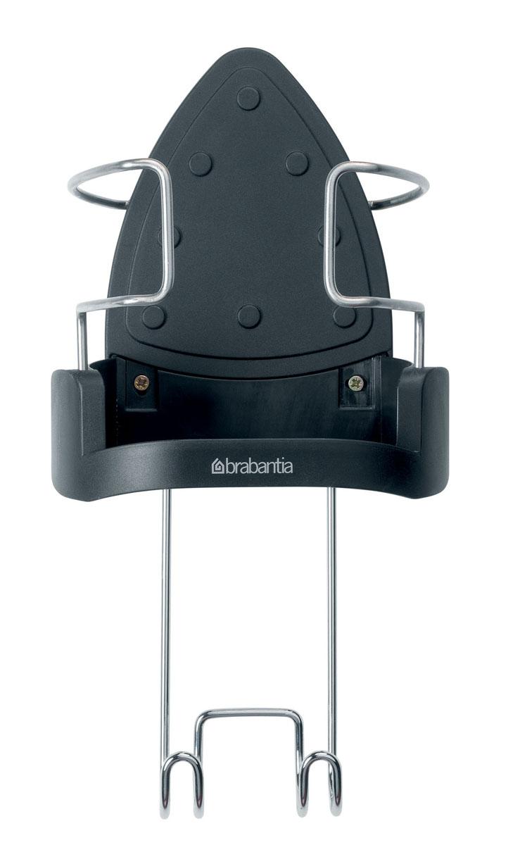 Подставка для утюга Brabantia, навесная. 385742GC220/05Подставка для утюга Brabantia подходит для всех современных моделей утюгов. Изготовлена из прочного жароустойчивого пластика, способного выдерживать температуру до 220°С. Вставки из нержавеющей стали надежно фиксируют утюг. Имеется крючок для подвешивания гладильных досок Brabantia. С задней стороны имеются отверстия для крепления подставки к стене. Крепежные элементы входят в комплект.Материал: пластик, нержавеющая сталь.Длина крючка: 21 см.