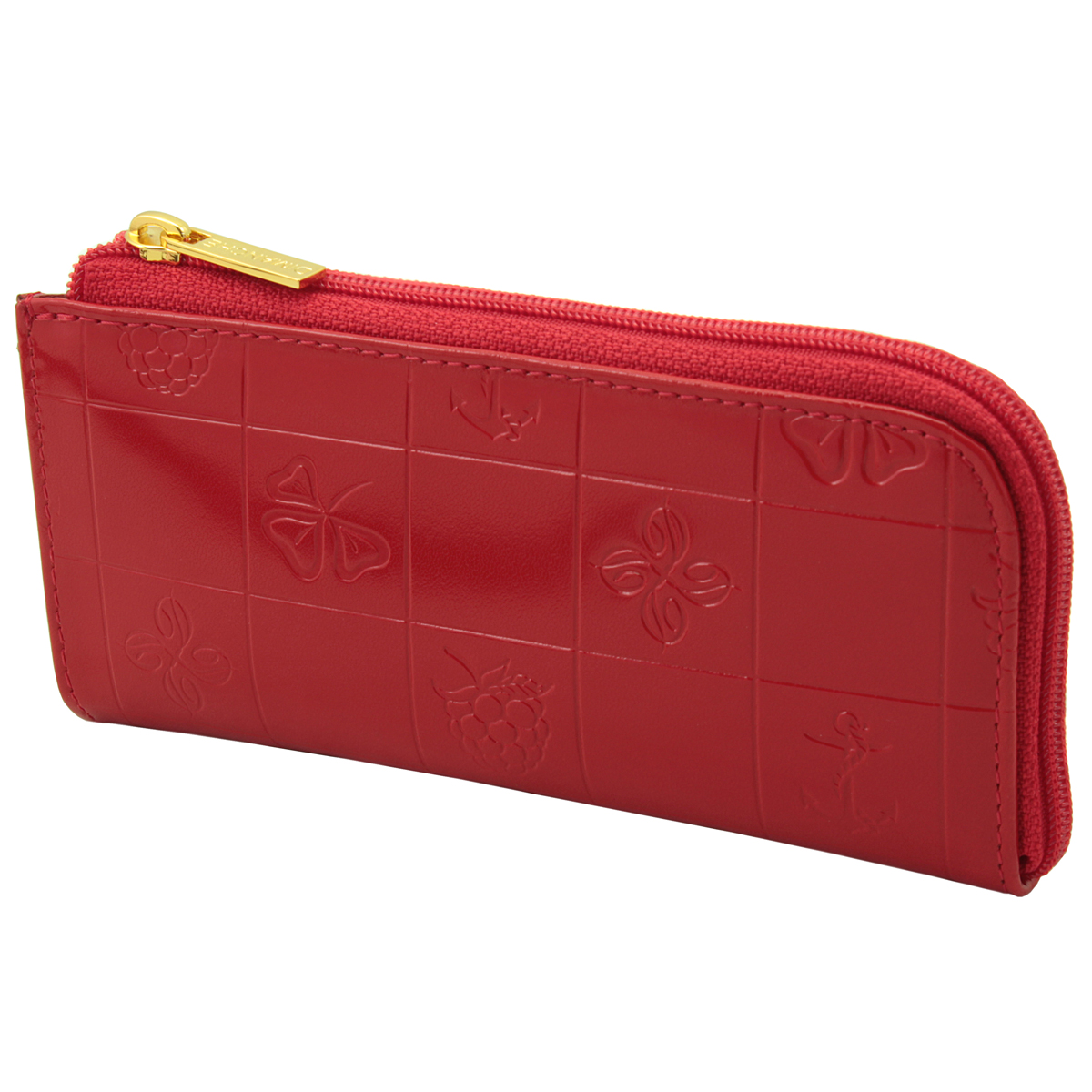 Ключница Dimanche Bonbon, цвет: красный. 21939890|Колье (короткие одноярусные бусы)Компактная ключница Bonbon - стильная вещь для хранения ключей. Ключница выполнена из натуральной кожи красного цвета с тиснением. Состоит из одного отделения, закрывающегося на застежку-молнию. Внутри ключницы на кожаной петле крепится металлическое кольцо для ключей. На внешней стороне расположен дополнительный карман на молнии. Ключница упакована в фирменную картонную коробку. Характеристики: Цвет: красный. Материал: натуральная кожа, текстиль, металл. Размер: 14 см x 7 см x 2 см. Изготовитель: Россия. Артикул: 219.