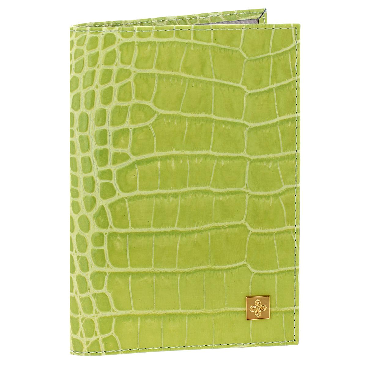 """Обложка для паспорта женская Dimanche Lime, цвет: лайм. 39135680Стильная обложка Lime выполнена из натуральной лаковой кожи с фактурным тиснением """"под крокодила"""". На внутреннем развороте расположено два вертикальных кармана из прозрачного пластика. Такая обложка не только поможет сохранить внешний вид ваших документов и защитит их от повреждений, но и станет ярким аксессуаром, который подчеркнет ваш образ. Обложка упакована в подарочную картонную коробку с логотипом фирмы. Характеристики:Материал: натуральная кожа, ПВХ. Размер обложки: 9,5 см х 13,5 см х 1,5 см. Цвет: лайм."""