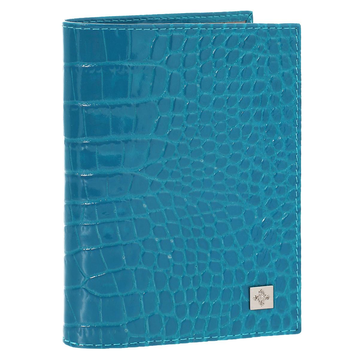 Обложка для паспорта Dimanche Электрик, цвет: лазурь. 950O.21.-1.cognacОбложка для паспорта Электрик выполнена из натуральной лаковой кожи с декоративным тиснением под крокодила. На внутреннем развороте - два кармашка из прозрачного пластика. Обложка не только поможет сохранить внешний вид ваших документов и защитит их от повреждений, но и станет стильным аксессуаром, который подчеркнет ваш неповторимый стиль.Обложка упакована в коробку из плотного картона с логотипом фирмы. Характеристики:Материал: натуральная кожа, ПВХ. Цвет: лазурь. Размер обложки: 9,5 см х 13,5 см х 1,5 см.