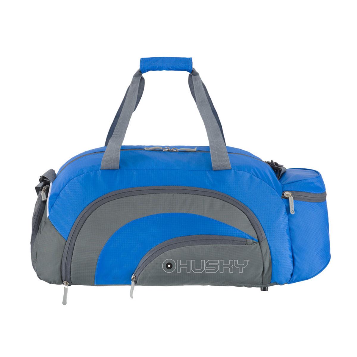 Сумка спортивная Husky Glade 38, цвет: синийГризлиКомфортная и практичная спортивная сумка Glade 38.Особенности модели: Водонепроницаемая ткань, Карман для обуви с вентиляцией, Три наружных кармана, Внутренний органайзер, Съемный наплечный ремень.