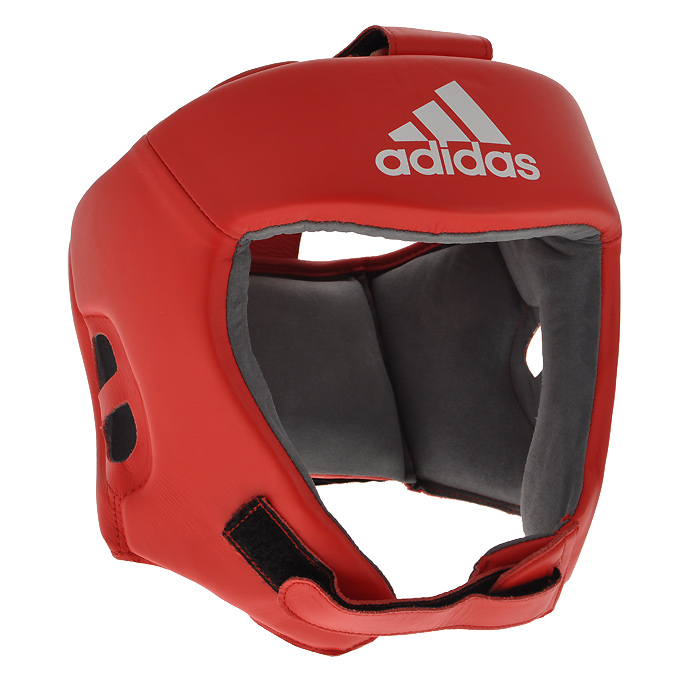 Шлем боксерский Adidas AIBA, цвет: красный. AIBAH1. Размер L (52-56 см)JTOI-10801Боксерский шлем Adidas AIBA разработан и спроектирован для обеспечения максимальной защиты и оптимальной видимости. Шлем сертифицирован Международной ассоциацией бокса (AIBA). Оболочка шлема изготовлена из натуральной кожи, что увеличивает срок эксплуатации шлема. Внутреннее наполнение из пены, изготовленной по технологии Air Cushion, обеспечивает отличную амортизацию ударных нагрузок. Внутренняя подкладка выполнена из высокотехнологичной, искусственной кожи Amara. Шлем имеет легкую конструкцию без защиты скул. Два широких ремня фиксируемых липучкой на теменной части и два ремня на липучке в затылочной части позволяют регулировать размер шлема и обеспечивают плотную и удобную посадку, исключая смещение шлема во время боя. Так же шлем имеет регулируемый ремешок под подбородком.