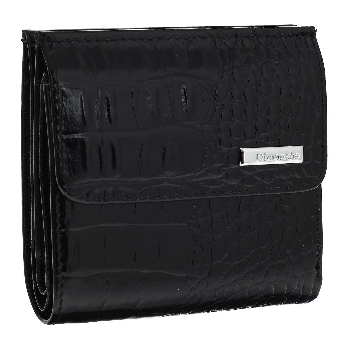 Кошелек женский Dimanche Loricata, цвет: черный. 4261-022_516Кошелек Dimanche Loricata изготовлен из натуральной кожи черного цвета с декоративным тиснением под рептилию. Закрывается на магнитную кнопку. На передней стенке расположен объемный карман для мелочи, закрывающийся на кнопку. Внутри кошелька содержится 2 отделения для купюр, дополнительный карман на молнии, 2 прорезных кармана для пластиковых карт, кармашек для сим-карты, 2 потайных вертикальных кармашка для мелких бумаг и окошко для фотографии. Внутри кошелек отделан атласным полиэстером черного цвета с узором. Фурнитура - серебристого цвета.Стильный кошелек отлично дополнит ваш образ и станет незаменимым аксессуаром на каждый день. Упакован в фирменную картонную коробку коричневого цвета.Характеристики: Материал: натуральная кожа, полиэстер, металл. Цвет: черный. Размер кошелька (ДхШхВ): 10 см х 10,5 см х 2,5 см.