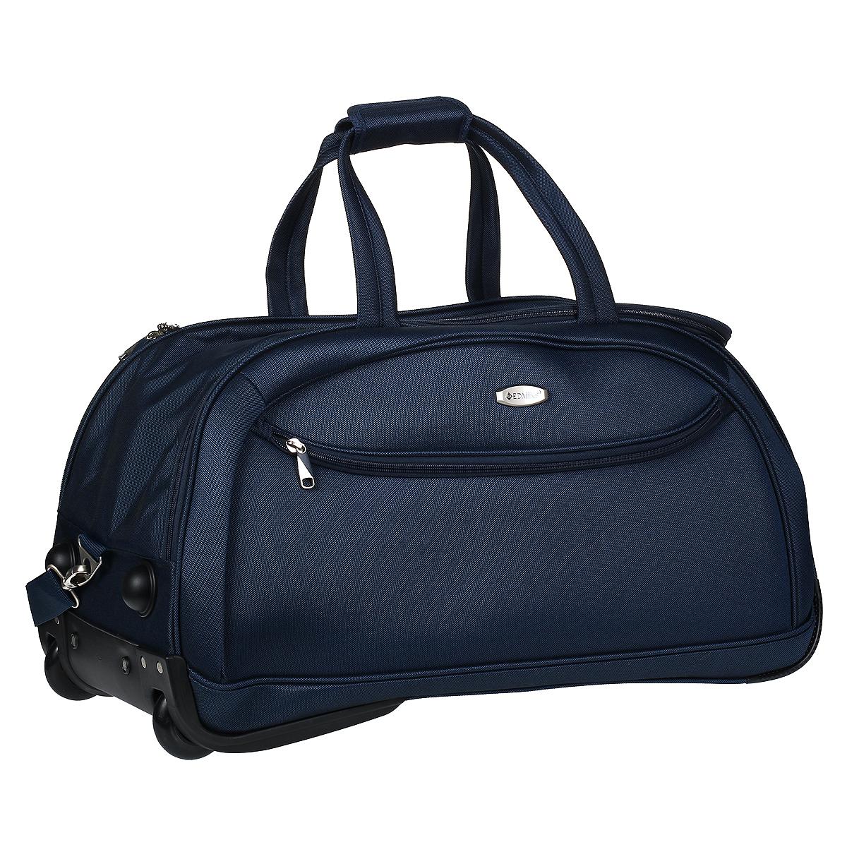 """Сумка дорожная Edmins на колесах, цвет: темно-синий. 213 НТВF5SA01Сумка-тележка Edmins идеально подходит для поездок и путешествий. Сумка изготовлена из плотного полиэстера темно-синего цвета. Сумка имеет одно вместительное основное отделение для хранения одежды и аксессуаров, которое закрывается на застежку-молнию с двумя бегунками. Внутри содержится вшитый карман на молнии, а также багажные ремни для фиксации. Внутренняя поверхность изделия отделана полиэстером серого цвета. С лицевой стороны сумки расположено дополнительное отделение на молнии. Сумка оснащена удобной телескопической ручкой, которая выдвигается нажатием на кнопку. Дно сумки имеет два колеса и две пластиковые """"ножки"""". Также сумка оснащена двумя короткими ручками для переноски и съемным плечевым ремнем.Сумка имеет кодовый замок, который крепится к бегункам основного отделения. В комплекте чехол для обуви.Стильная и удобная сумка-тележка Edmins вместит все необходимые вещи и станет незаменимым аксессуаром во время поездок. Особенности: - Замок: кодовый;- Багажные ремни в главном отделении;- Плечевой ремень; - Боковая и телескопическая ручки; - Ножки на боковой стороне; - Мешок для обуви;- Число колес: 2. Характеристики:Материал: полиэстер, металл, пластик. Цвет: темно-синий. Размер сумки (ДхШхВ): 65 см х 38 см х 34 см. Максимальная нагрузка: 17 кг. Количество колес: 2 шт. Высота выдвижной ручки: 23 см."""