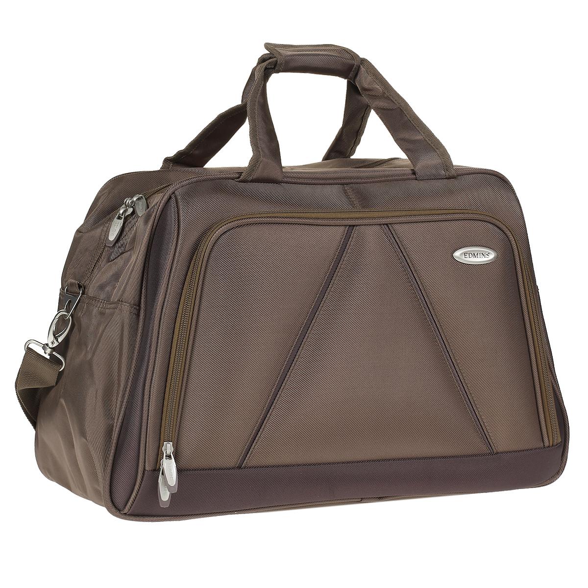Сумка дорожная Edmins, цвет: бронза. 243 CVFABLSEH10002Стильная дорожная сумка Edmins выполнена из плотного полиэстера бронзового цвета. Сумка имеет одно вместительное отделение, закрывающееся на застежку-молнию. Сумка снабжена механическим замком с двумя ключами. Внутри содержится вшитый карман на молнии и перегородка. На лицевой стороне расположен накладной карман на молнии. На задней стенке - карман для мелочей на липучке. Сумка оснащена двумя удобными ручками и отстегивающимся плечевым ремнем регулируемой длины. На дне - пластиковые ножки. Фурнитура - серебристого цвета. Функциональная и вместительная, такая сумка поможет не только уместить все необходимые вещи, но и станет модным аксессуаром, который идеально дополнит ваш образ. Может использоваться в качестве ручной клади. Характеристики:Материал: полиэстер, металл, пластик.Размер сумки: 50 см х 30 см х 25 см.Цвет: бронза. Высота ручек: 20 см. Длина плечевого ремня (регулируется): 75 см. Максимальная нагрузка: 7 кг.