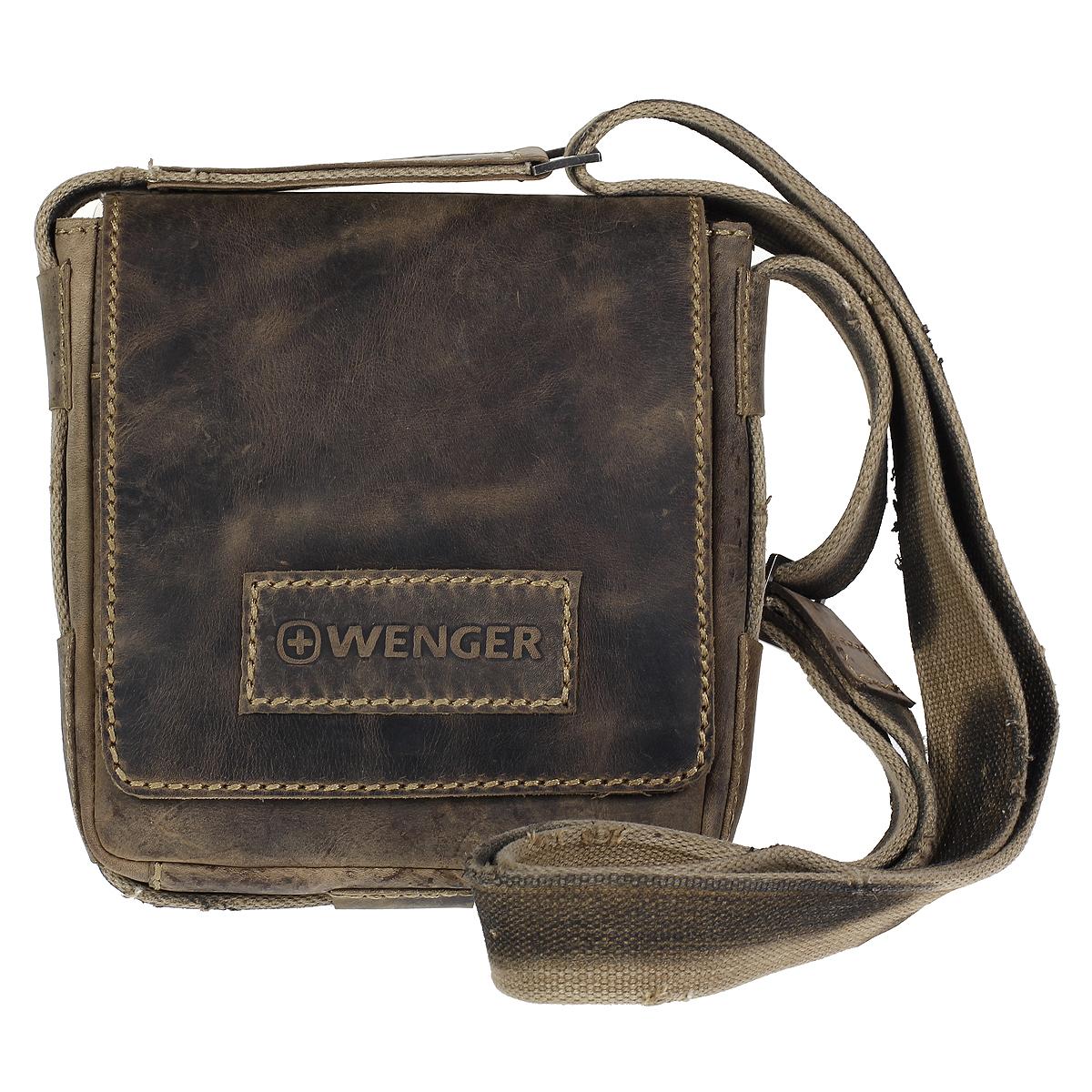 Сумка-планшет мужская Wenger Stonehide, цвет: светло-коричневый. W16-018-2Сумка-планшет Wenger Stonehide выполнена из крепкой эластичной бычьей кожи, обработанной по традиционной технологии - грубые швы, состаренные ремни. Такая сумка будет уместна везде - на деловой встрече, учебе или работе.Сумка имеет одно отделение и закрывается широким клапаном на магнитную кнопку. Внутри - вшитый карман на молнии, шесть кармашков для кредиток или визитных карточек, два держателя для пишущих инструментов, карман для мобильного телефона и открытый накладной кармашек для мелочей. На задней стенке - вшитый карман на молнии. Сумка-планшет оснащена текстильным плечевым ремнем регулируемой длины. Стильная, практичная и компактная сумка-планшет в стиле кэжуал - для современного мужчины. Кожаные сумки Wenger - модные, функциональные, высококачественные сумки с уникальным дизайном.По всем вопросам гарантийного и постгарантийного обслуживания рюкзаков, чемоданов, спортивных и кожаных сумок, а также портмоне марок Wenger и SwissGear вы можете обратиться в сервис-центр, расположенный по адресу: г. Москва, Саввинская набережная, д.3. Тел: (495) 788-39-96, (499) 248-56-56, ежедневно с 9:00 до 21:00. Подробные условия гарантийного обслуживания приведены в гарантийном талоне, поставляемым в комплекте с каждым изделием. Бесплатный ремонт изделий производится при условии предоставления гарантийного талона и товарного/кассового чека, подтверждающего дату покупки. Характеристики: Материал: натуральная бычья кожа, текстиль, металл. Цвет: светло-коричневый. Размер сумки: 20 см х 22 см х 7 см.