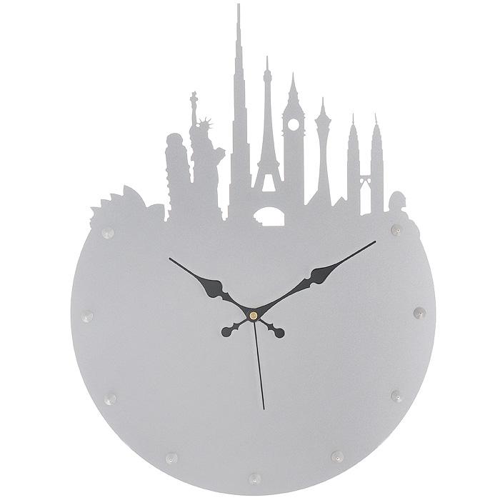 Часы настенные Башни, цвет: серебристый. 95182654290Изящные настенные часы Башни эффектно украсят интерьер помещения. Дизайн, полный хрупкого изящества, в этих часах удачно сочетается с высокой прочностью материалов. Корпус выполнен из коррозионностойкой стали с порошковым напылением серебристого цвета. Несмотря на устойчивый к механическим воздействиям корпус, часы выглядят ажурными, словно вырезанными из бумаги. Постоянное движение секундной стрелки придает фигуркам в виде самых знаменитых башен мира иллюзию постоянного трепета. Механизм часов - кварцевый. С задней стороны корпуса имеется отверстие для подвешивания на стену. Красивые и качественные настенные часы украсят современный интерьер и порадуют надежной работой. Характеристики:Материал: коррозионностойкая сталь, пластик. Диаметр корпуса: 36 см. Высота часов (с декоративными элементами): 49 см. Толщина корпуса: 2 мм. Цвет: серебристый. Необходимо докупить одна батарейку типа АА (в комплект не входит).