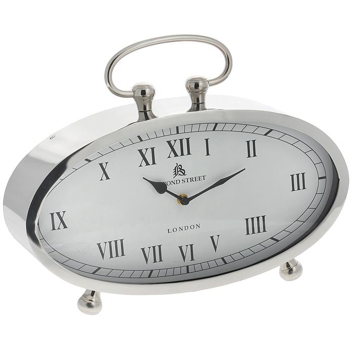 Часы настольные Win Max. 35819300074_ежевикаОригинальные настольные часы Win Max оснащены кварцевым механизмом. Часы имеют овальный корпус, выполненный из металла серебристого цвета. Циферблат часов белого цвета оснащен двумя стрелками - часовой и минутной; имеет индикацию римскими цифрами. Часы снабжены ручкой и двумя ножками для большей устойчивости.Такие настольные часы станут оригинальным украшением дома или интерьера вашего кабинета. Характеристики: Материал: пластик, стекло, металл (железо). Размер корпуса (ДхШхВ): 40 см х 10 см х 21 см. Высота часов (с ручкой): 31 см. Размер циферблата: 37 см х 18 см.