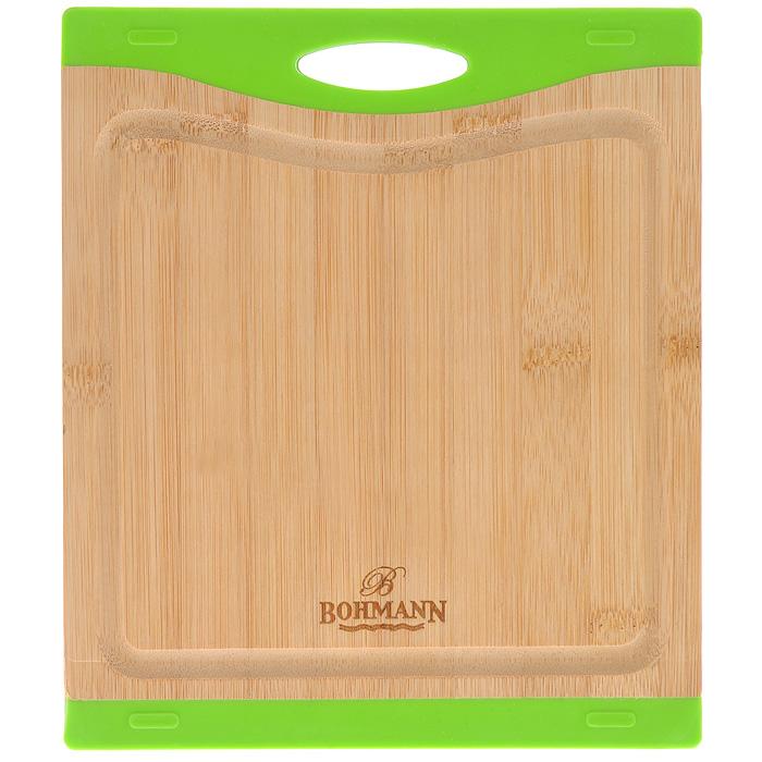 Доска разделочная Bohmann, бамбуковая, 23 см х 20,5 см. 02502BH391602Разделочная доска Bohmann изготовлена из бамбука. Бамбук - это абсолютно экологически чистый материал, который в первую очередь ценится за свою устойчивость к сильным нагрузкам и обладает повышенной влагостойкостью. Поверхность бамбуковых досок твердая и гладкая. Кроме того, такие доски обладают хорошими водоотталкивающими и антибактериальными свойствами. Доска не впитывает влагу, легко моется, не деформируется. Может использоваться как подставка под горячее. Благодаря вставкам из силикона доска не скользит по столу. Доска оснащена желобками, куда стекает лишняя жидкость при нарезке продуктов. Не рекомендуется мыть в посудомоечной машине.