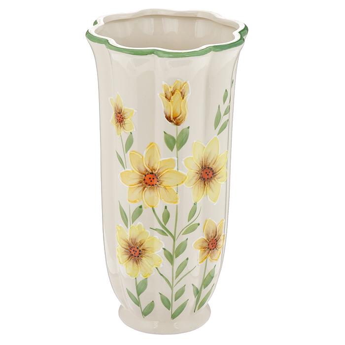 Ваза Цинния, керамическая, высота 25 см. 559-01214907Ваза Цинния, выполненная из керамики, украсит интерьер вашего дома или офиса. Оригинальный дизайн и красочное исполнение создадут праздничное настроение.Вы можете поставить вазу в любом месте, где она будет удачно смотреться, и радовать глаз. Такая ваза подойдет и для цветов, и для декора интерьера. Кроме того - это отличный вариант подарка для ваших близких и друзей. Характеристики:Материал:керамика. Цвет: бежевый, желтый, зеленый. Высота вазы: 25 см. Диаметр вазы по дну: 13,5 см. Диаметр горлышка вазы: 7 см. Изготовитель: Китай.