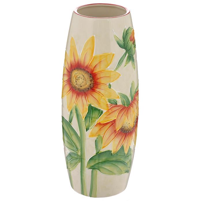 Ваза Подсолнух, керамическая, высота 25 см. 559-137737950Ваза Подсолнух, выполненная из керамики, украсит интерьер вашего дома или офиса. Оригинальный дизайн и красочное исполнение создадут праздничное настроение.Вы можете поставить вазу в любом месте, где она будет удачно смотреться, и радовать глаз. Такая ваза подойдет и для цветов, и для декора интерьера. Кроме того - это отличный вариант подарка для ваших близких и друзей. Характеристики:Материал:керамика. Цвет: бежевый, желтый, зеленый. Высота вазы: 25 см. Диаметр вазы по дну: 7,5 см. Диаметр горлышка вазы: 7 см. Изготовитель: Китай.