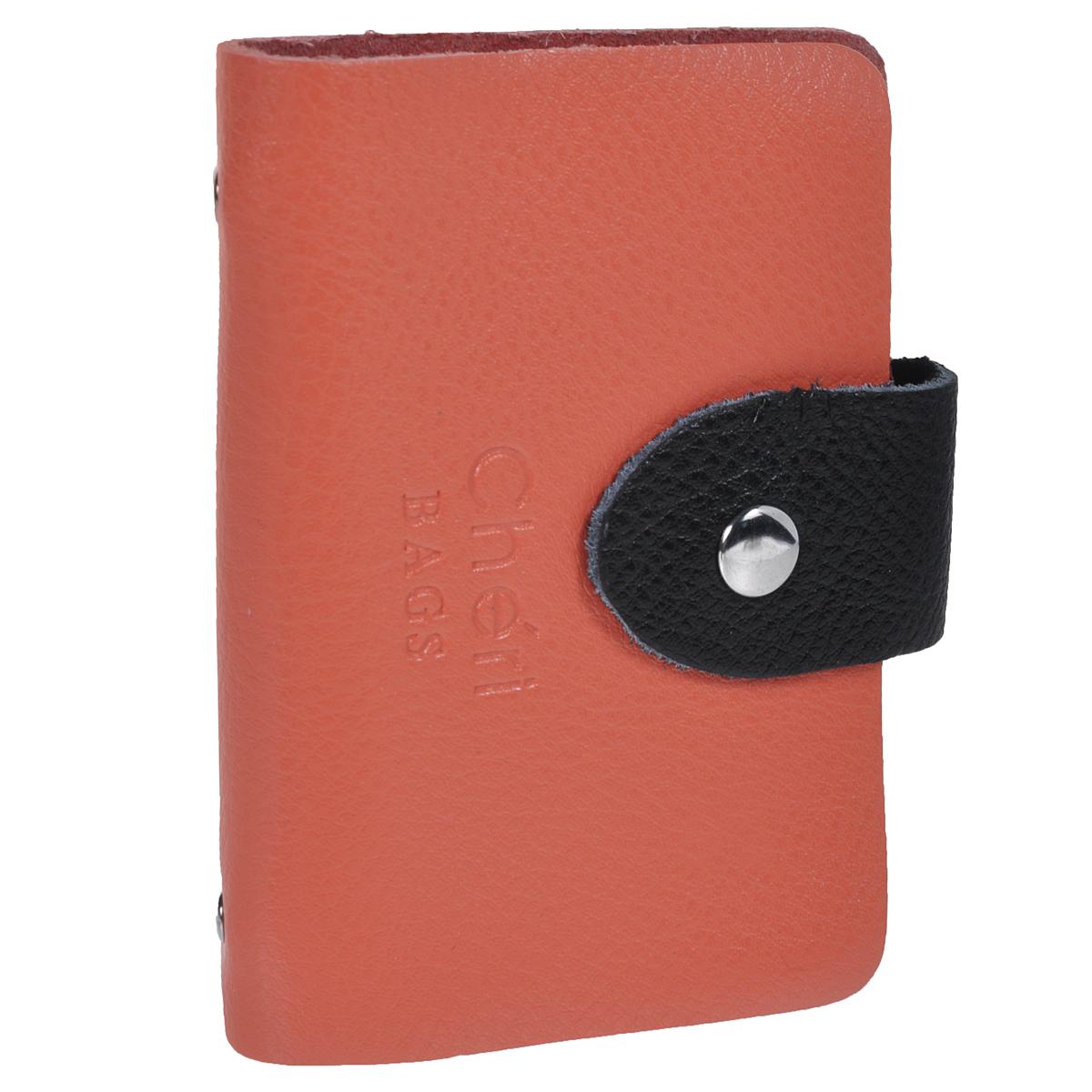 Визитница Cheribags, цвет: коралловый, черный. V-0498-32993224Трендовая визитница Cheribags изготовлена из натуральной кожи и декорирована тисненым названием бренда спереди. Изделие закрывается хлястиком на кнопку. Внутри - блок из прозрачного мягкого пластика на 26 визиток, который крепится к корпусу визитницы на металлические заклепки.Стильная визитница - это не только практичная вещь для хранения пластиковых карт, но и модный аксессуар, который подчеркнет ваш неповторимый стиль.